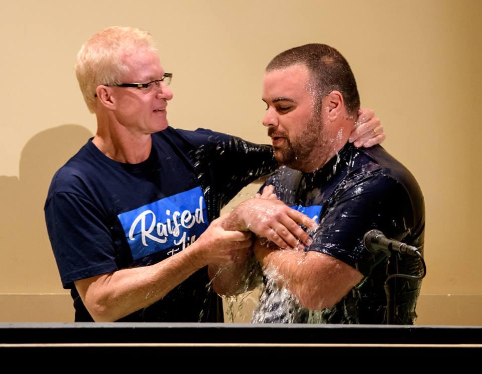 Pastor Jeff baptizes Cory St. Esprit on Easter Sunday.