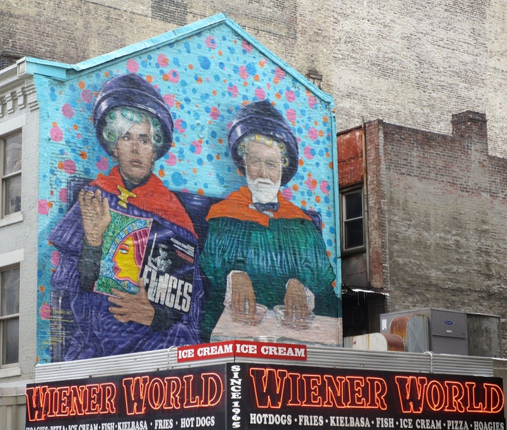 A mural depicting 'The Two Andys' — Warhol and Carnegie — was part of Pastor Jeff's walking tour of Pittsburgh.