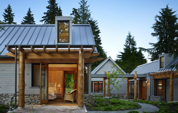Metal panel roofing, applied in sheets, has raised ribs. Photo: David Vandervort Architects