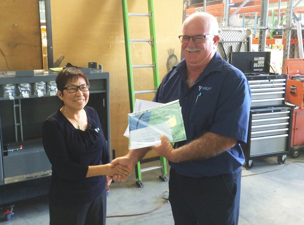 Eva receives her long service award from Varley's Queensland Operations Manager, Brendan Freshwater.