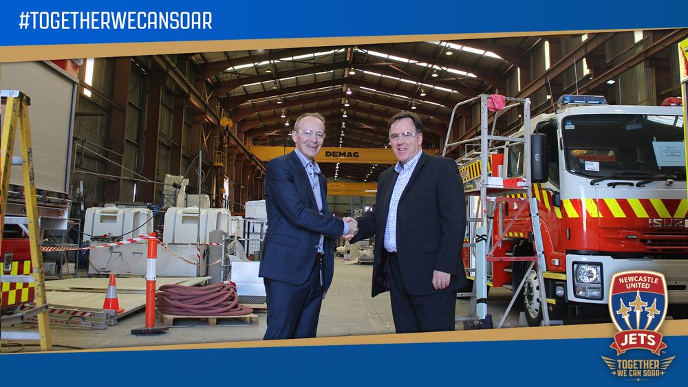 Varley Group MD, Jeff Phillips, with Newcastle Jets CEO, Lawrie McKinna, at Varley's Tomago facility this week.