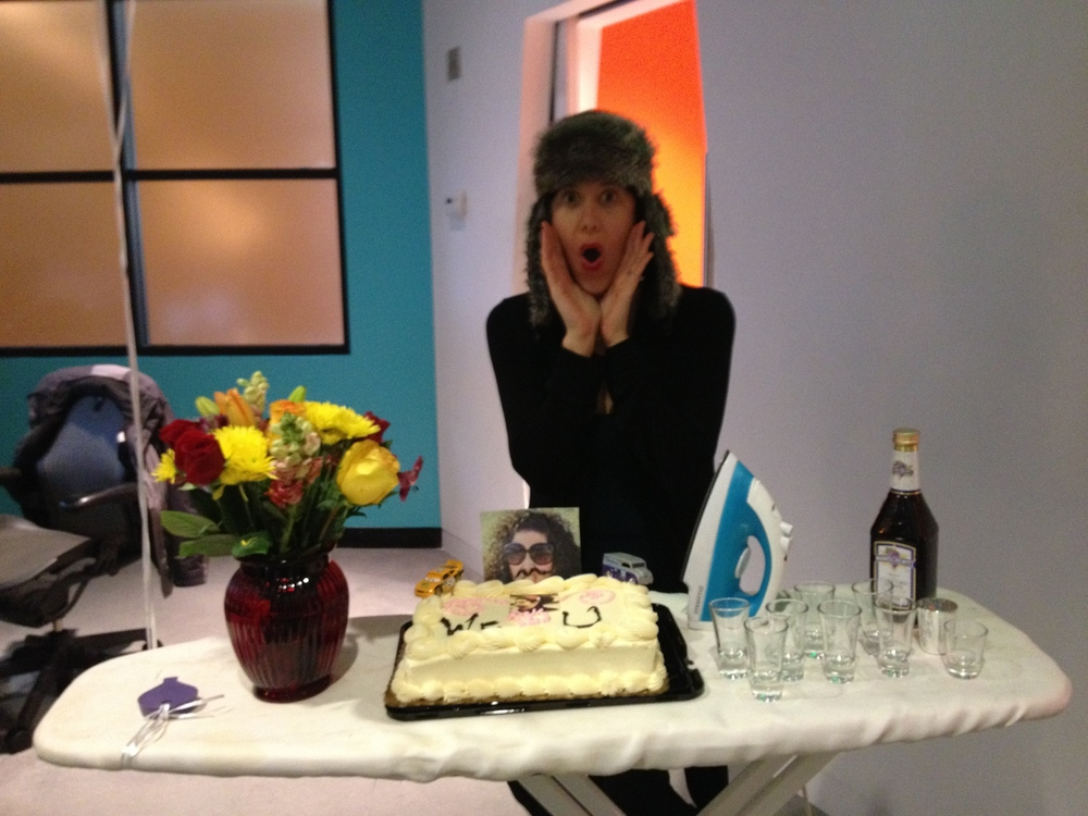 My going away party at TSG with a face cake, and shots of Manischewitz all displayed on an ironing board.