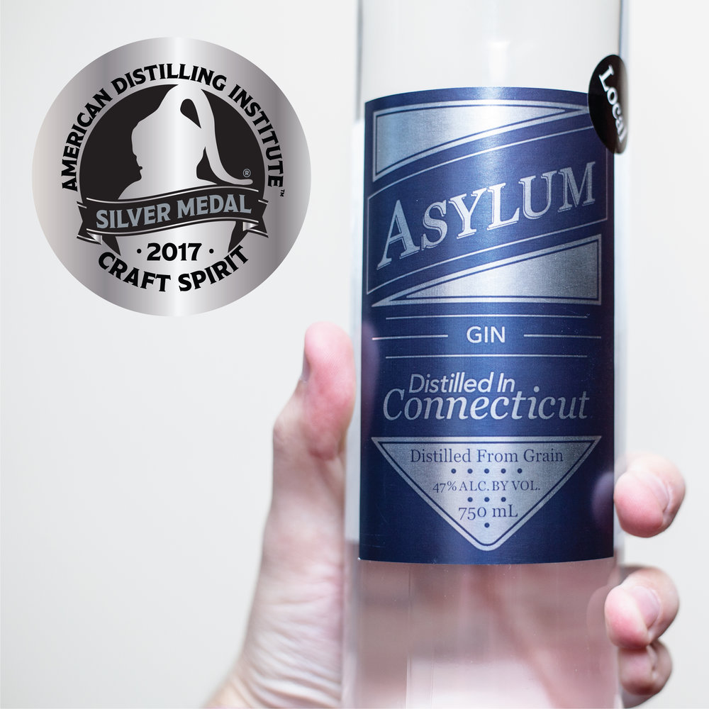 Asylum Gin Our award winning  gin is made with a blend of select traditional botanicals.  Asylum Gin is crafted with spirits that we distill ourselves in Connecticut from Connecticut grown grain. Where To Buy ---------------------------------- Drinks to Try: Asylum Gimlet or Sour 2 oz Asylum Gin 3/4 oz Lime or Lemon 3/4 oz Simple Syrup - Shake with ice - Strain & Enjoy ---------- Asylum G&T 2 oz Asylum Gin Tonic Water Lime Wedges - Add Asylum Gin to highball glass with ice - Garnish with a lime wedge Try with Asylum Vodka or Corn Whiskey ---------- Asylum Collins 2 oz Asylum Gin 3/4 oz Lemon Juice 3/4 oz simple syrup Club Soda Lemon Wedge & Cherry - Add Asylum Gin, lemon juice & simple syrup to collins glass with ice - Top up with club soda - Garnish with a lemon wedge & cherry Try with Asylum Vodka or Corn Whiskey ----------