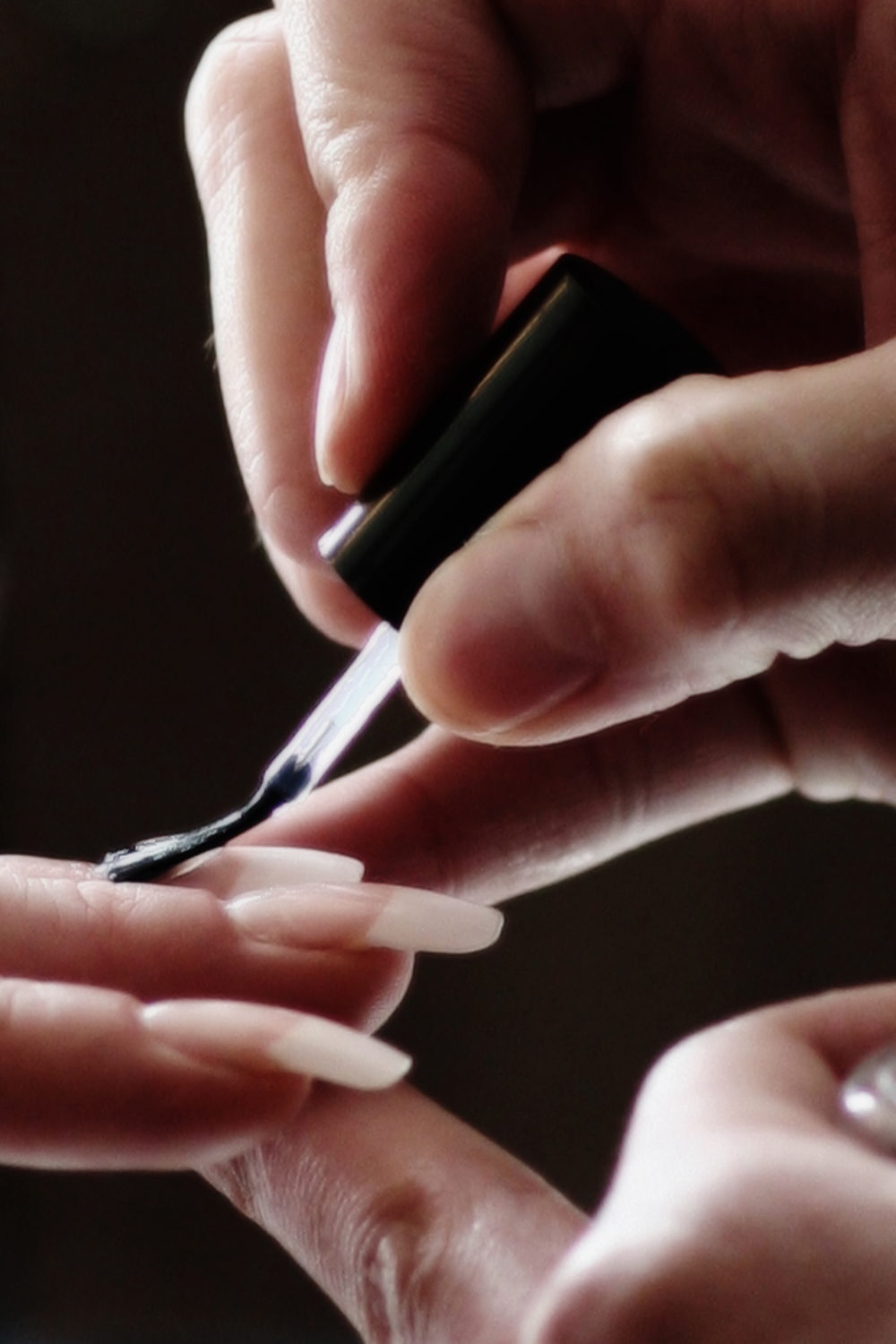 The bride gets a manicure during the getting ready moments at her wedding at the Ritz Carlton Sarasota.