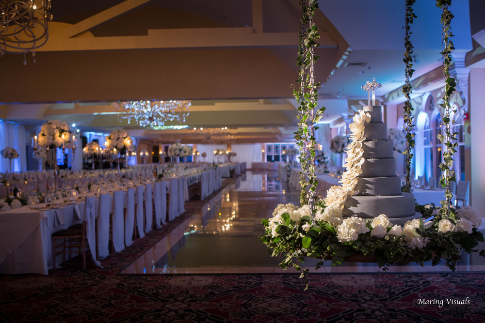 The wedding cake becomes a central decor piece and a visual for guests as they enter the room.