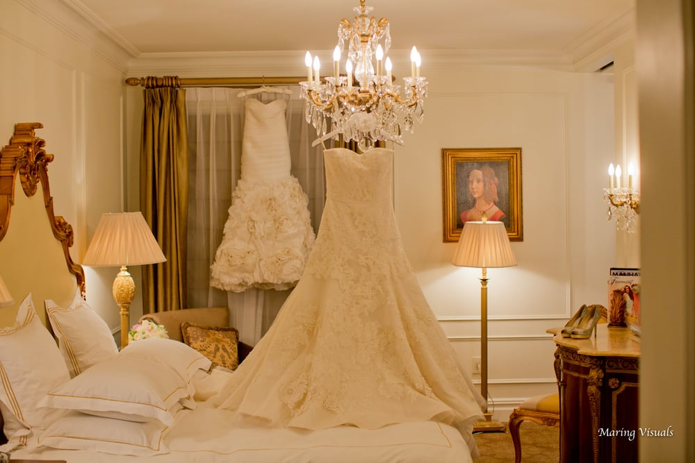 The Bride's dresses hung perfectly as a focal point in the room for all to enjoy at The Plaza Hotel NYC