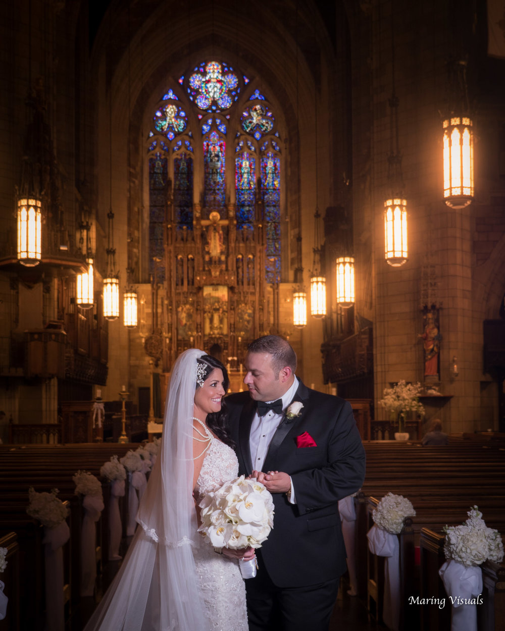 Taking portraits in the center aisle rather than the alter adds grandeur.