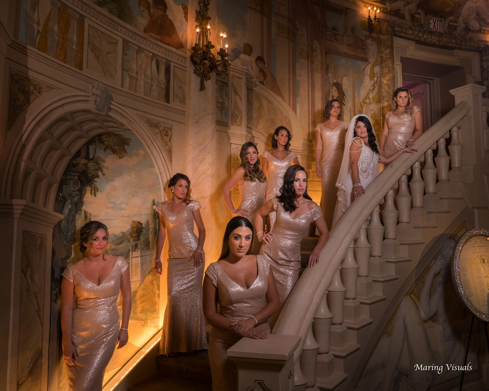Fashionable bridal party photographs in The Rotunda at The Pierre Hotel