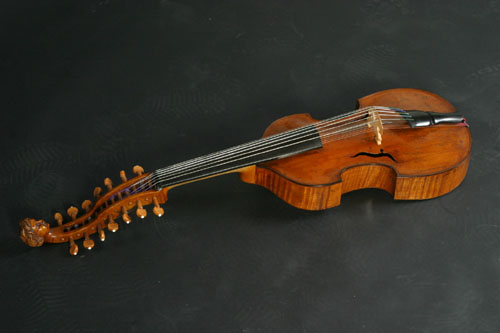 The viola d'amore is a 6 or 7 stringed instrument held under the chin and was popular in the Baroque era.