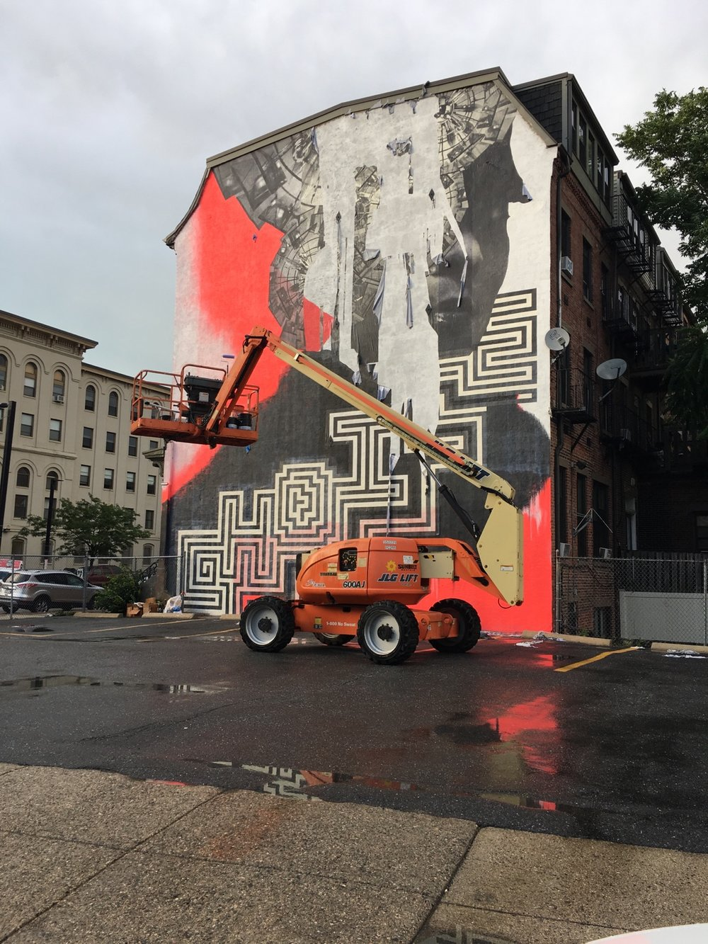 See Her  was near completion when a fierce, fast moving storm barreled through Boston on June 29, peeling off the photo elements of the mural.