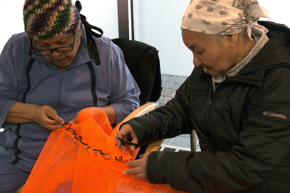 Members of the IBA community come together to help stitch and embroider the main tapestry of  UNLESS.
