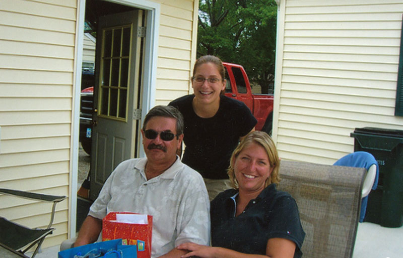 Paul and his daughters Stephanie (standing) and Heather.
