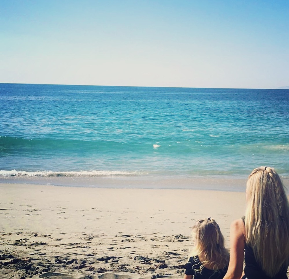 Last fall in Laguna Beach.  She loves when we do our hair the same!