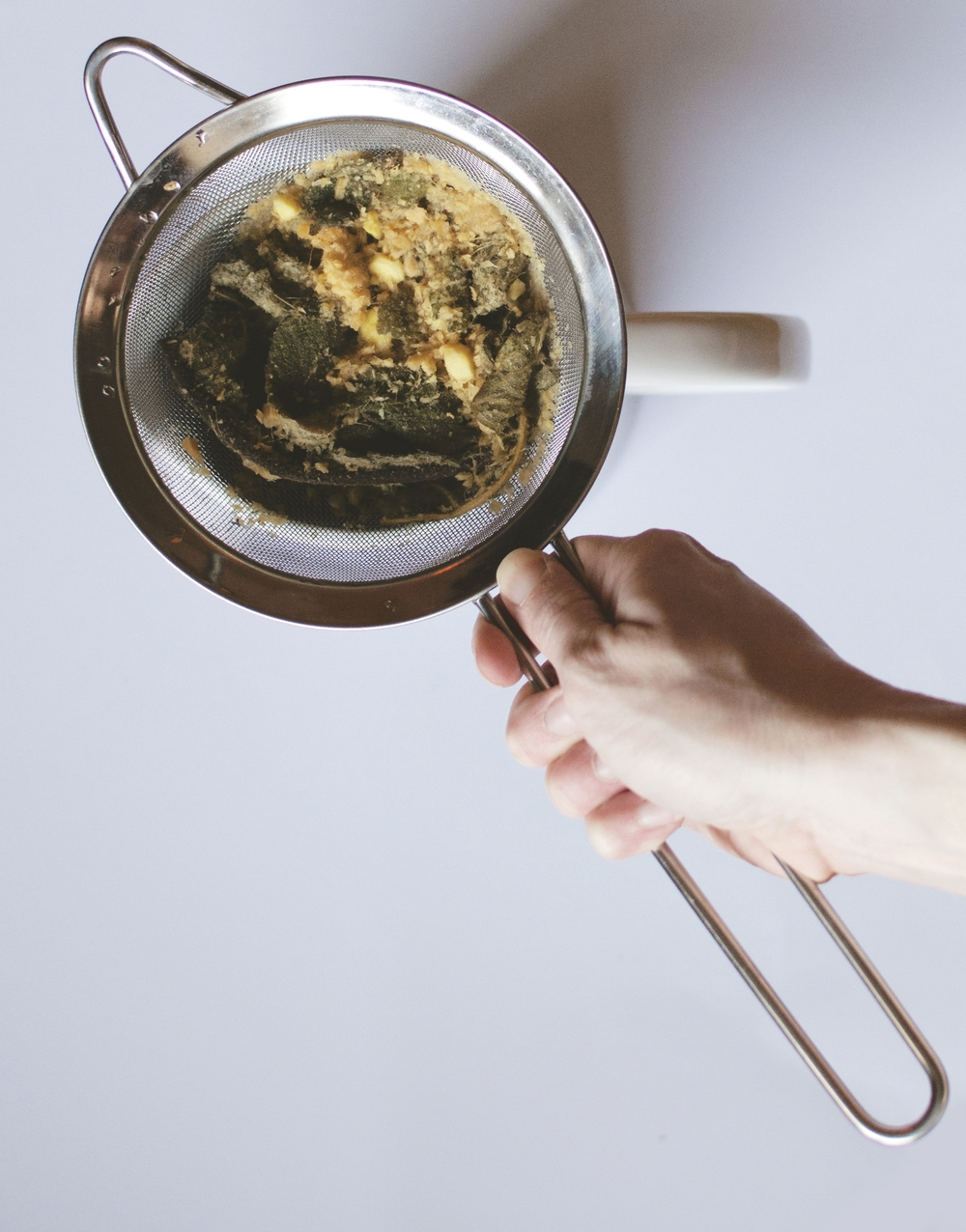 After boiling for about 10 minutes, use a mesh strainer to filter out the mullein and ginger.