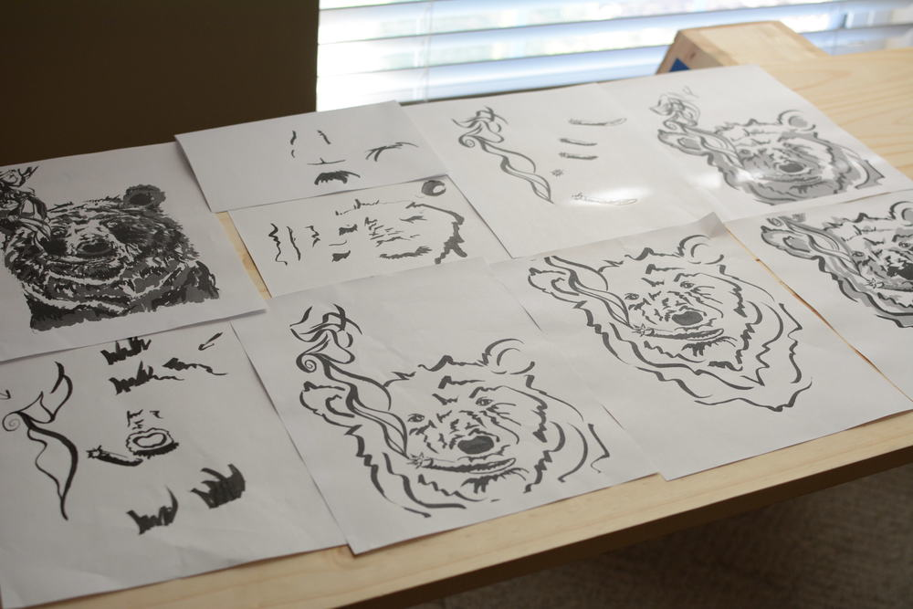 I started with a printed image of the original smokey, and began illustrating over him on my light box.