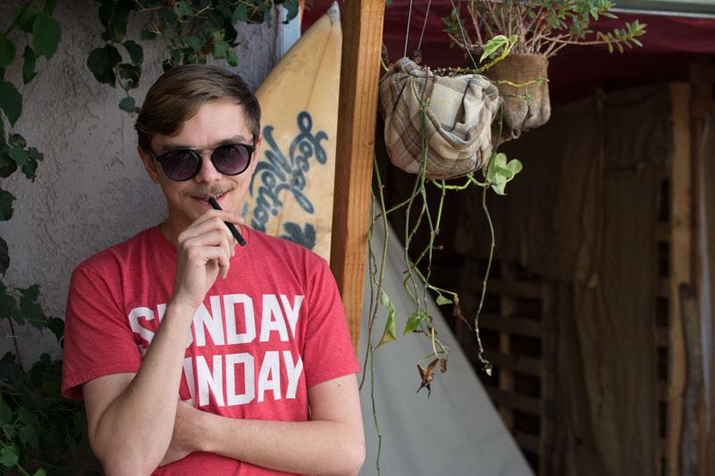 sunglasses-surfboard-smile-guy-evoxe-800px.jpg