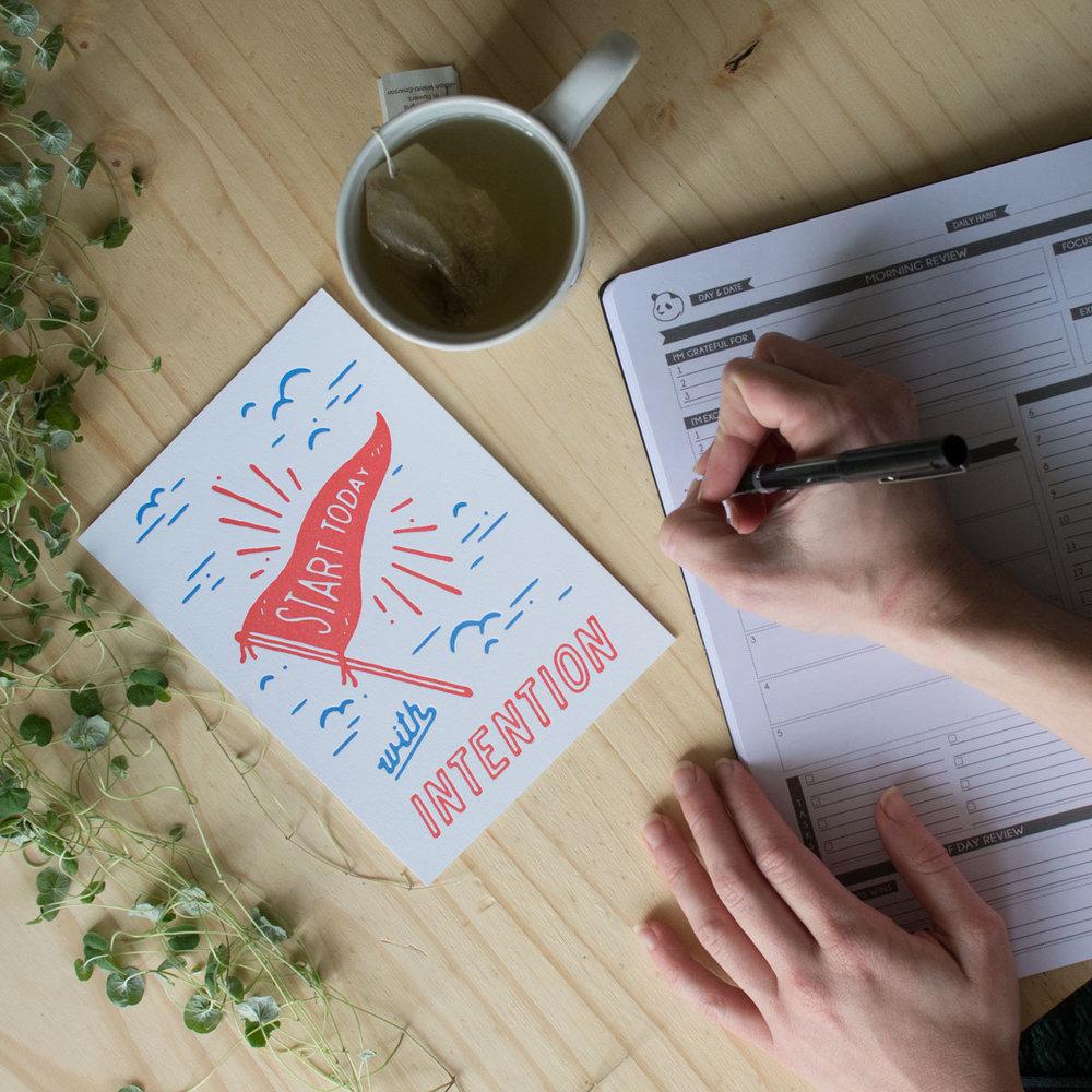 planner-hands-tea-intention-holstee-1200px.jpg