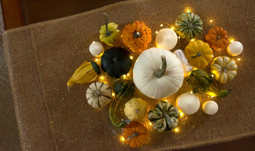 My personal favorite part of the event — an arrangement of gourds & pumpkins on burlap with gold interlaced!