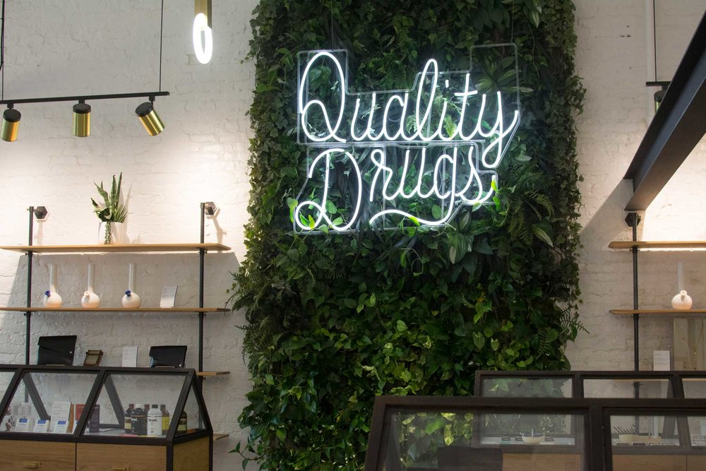 "The phrase ""Quality Drugs"" appears in Serra stores as an ""homage to past apothecary aesthetic"""