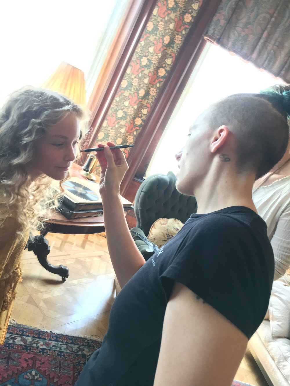 Bethany doing make up touch up on set