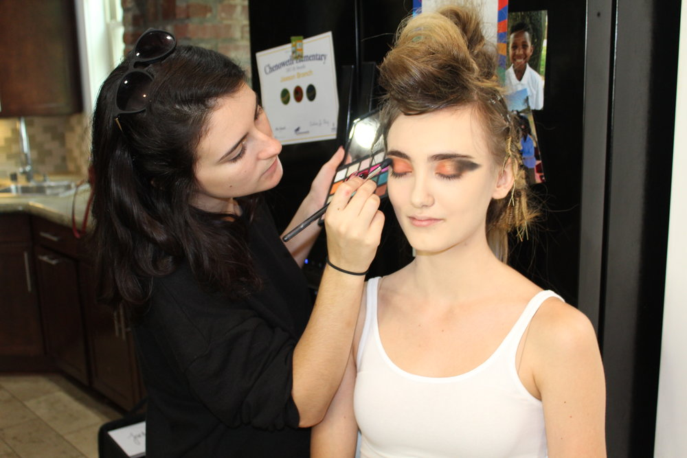 a painters canvas: mua Rebecca shaping the eyes of model Olive