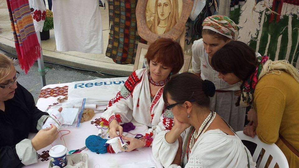 Instructor Myroslava demonstrating a traditional joining stitch at the Bloor West Ukrainian Festival 2016.