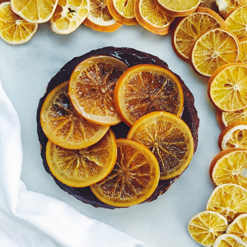 Claudia Roden's famous orange cake gets a decadent makeover with chocolate ganache and candied oranges. Here's our adaptation of the recipe.