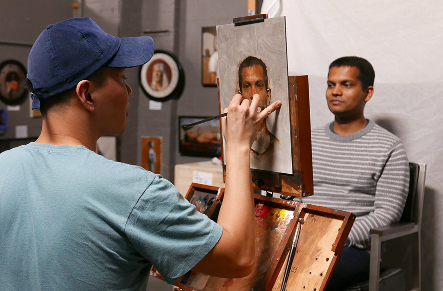 Nik Sharma sitting for his portrait with oil painter Patrick Byrnes in Patrick's Long Island City studio.