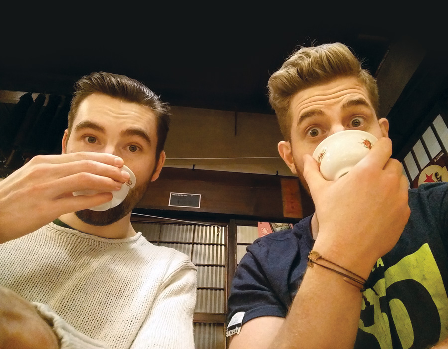 Adam (left) and his boyfriend Kristos sipping warm saké in Heinraku, Takayama.