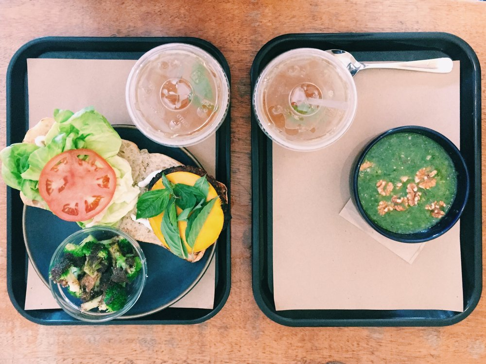 "LEFT: Vegan ""Cheeseburger"" with Broccoli in Sumac Vinaigrette. RIGHT: Green Gazpacho with Walnuts."