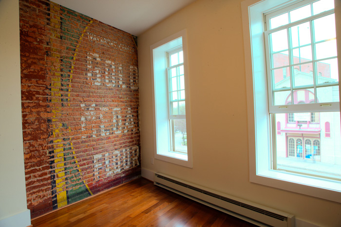 Restored brick wall in contemporary apartment