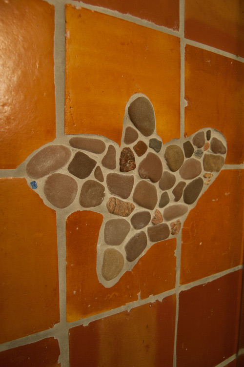 Terra cotta tile with pebble inlay