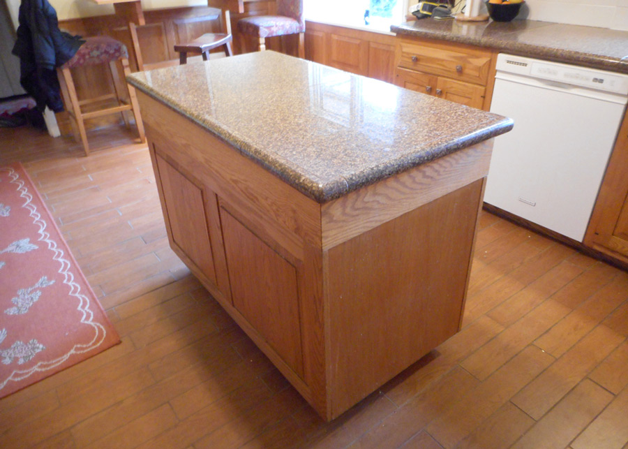 Granite tile countertop, ceramic plank floor