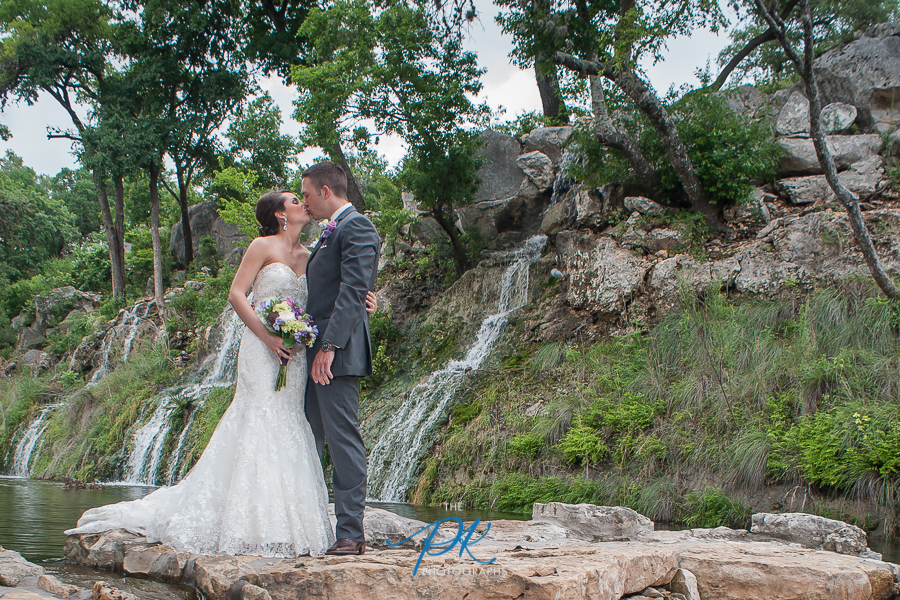 Bride and Groom with Waterfall, at the Lodge at Bridal Veil Falls   -   San Antonio Wedding Photographer
