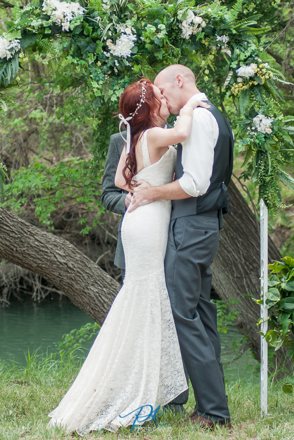 First Kiss at Haven River Inn - San Antonio Wedding Photographer