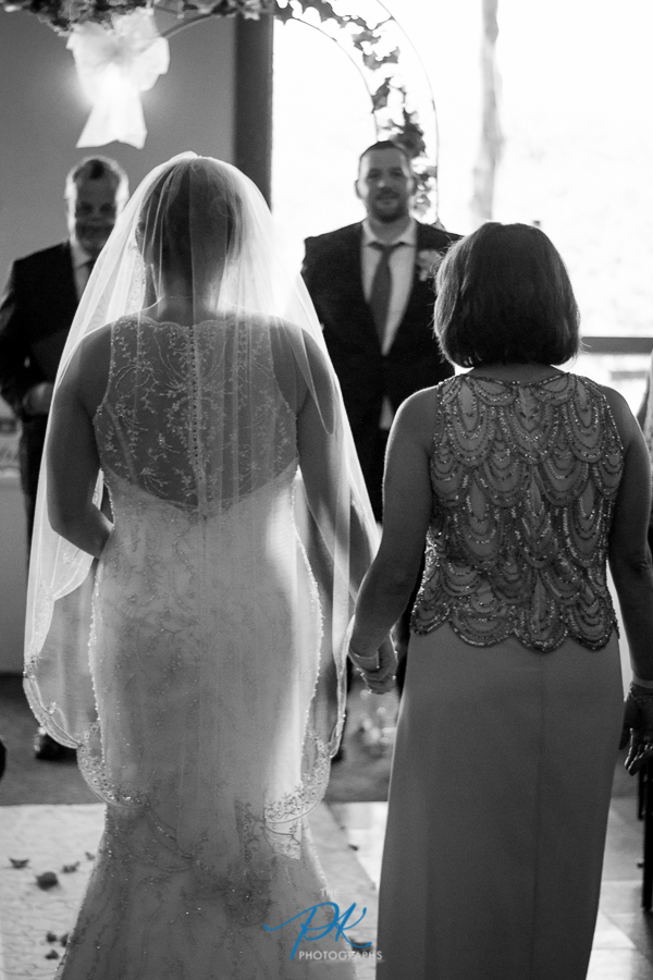 Monica walking up the aisle to her soon-to-be husband.