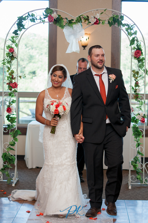 Finally husband and wife, Monica and Jimmy were all smiles heading back up the wedding aisle!