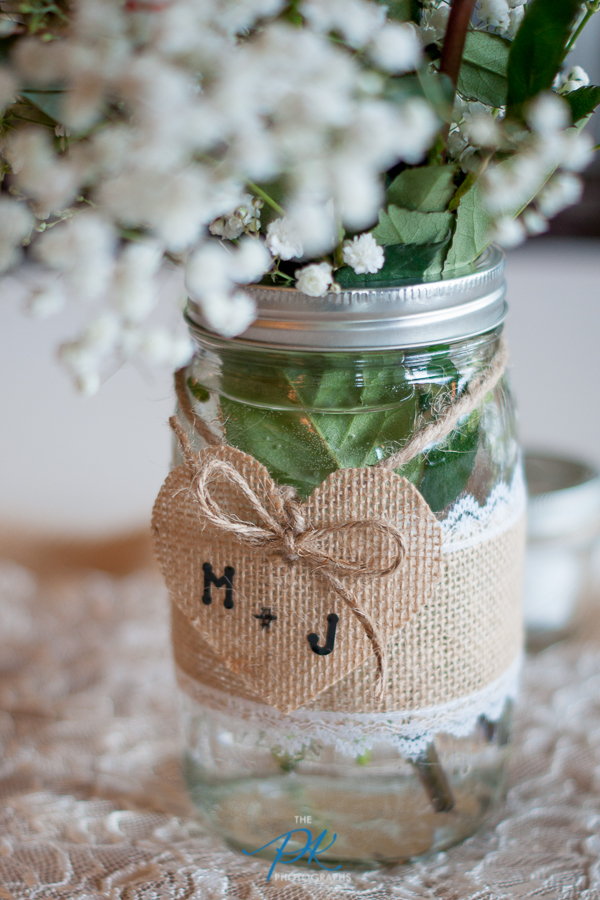 The bride and groom included their initials on the centerpieces on their reception tables.