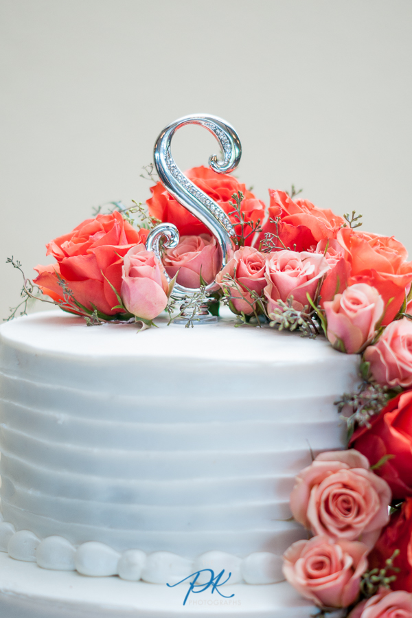 Their last initial made such a simple and classic cake topper