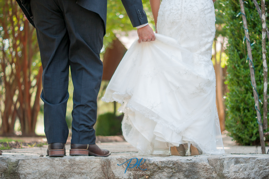 groom-holding-bride-dress-stairs-helping.jpg
