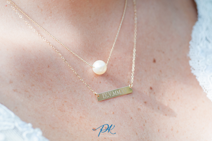One of her necklaces was engraved with their wedding date.