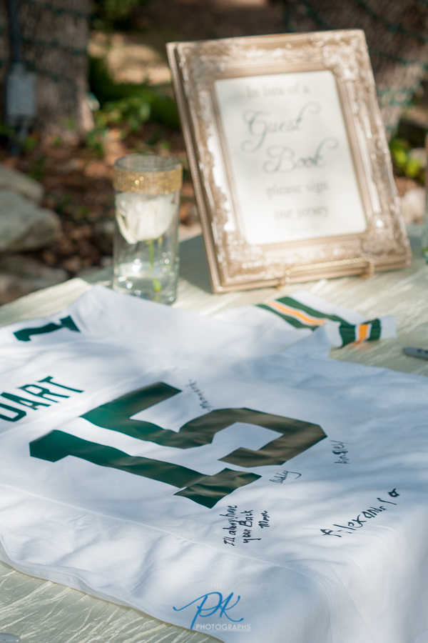 Instead of a wedding guestbook, Denise and Brian had guests sign a custom jersey.