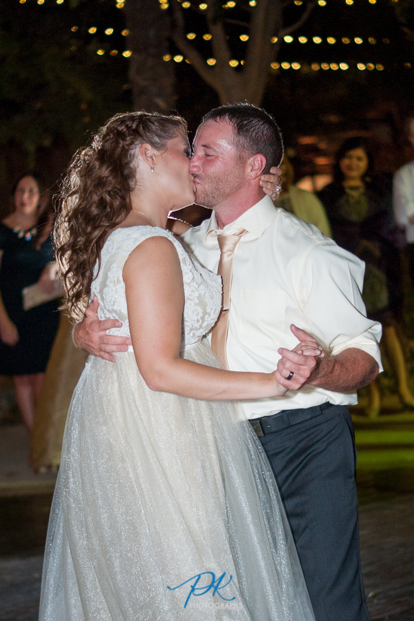 gardens-old-town-helotes-bride-groom-dancing-wedding-reception-kiss.jpg