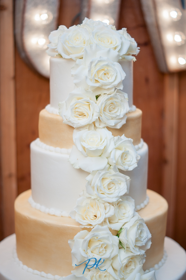 four-tier-flowers-wedding-cake-texas-gold-white-beige.jpg