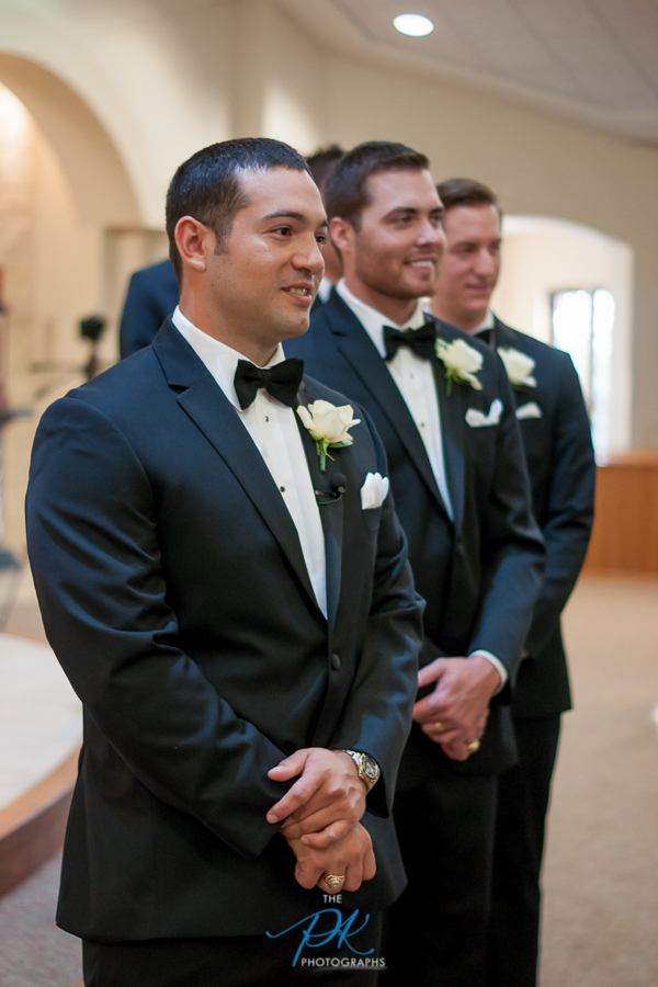 groom-waiting-for-bride-st-joseph-catholic-church-spring-branch-texas.jpg