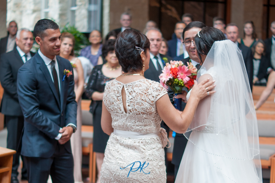 Bride walking up aisle at St. Peter the Apostle Catholic Church - San Antonio Wedding Photographer