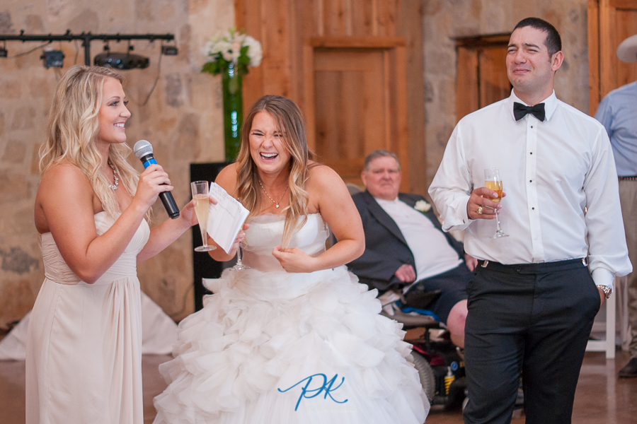Bride laughing at maid of honor's toast.