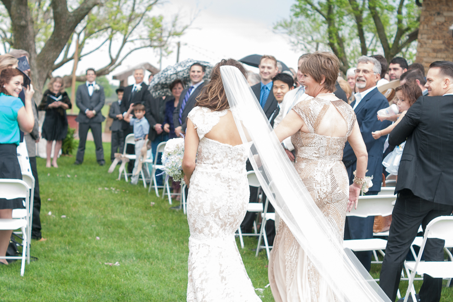 Bride Walking up the Aisle at the Lodge at Country Inn Cottages | San Antonio Wedding Photographer