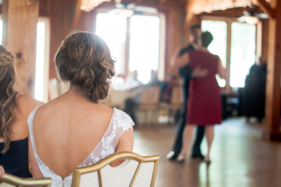Bride Watching Groom Dance at Spinelli's Hill Country Wedding Venue | San Antonio Wedding Photographer