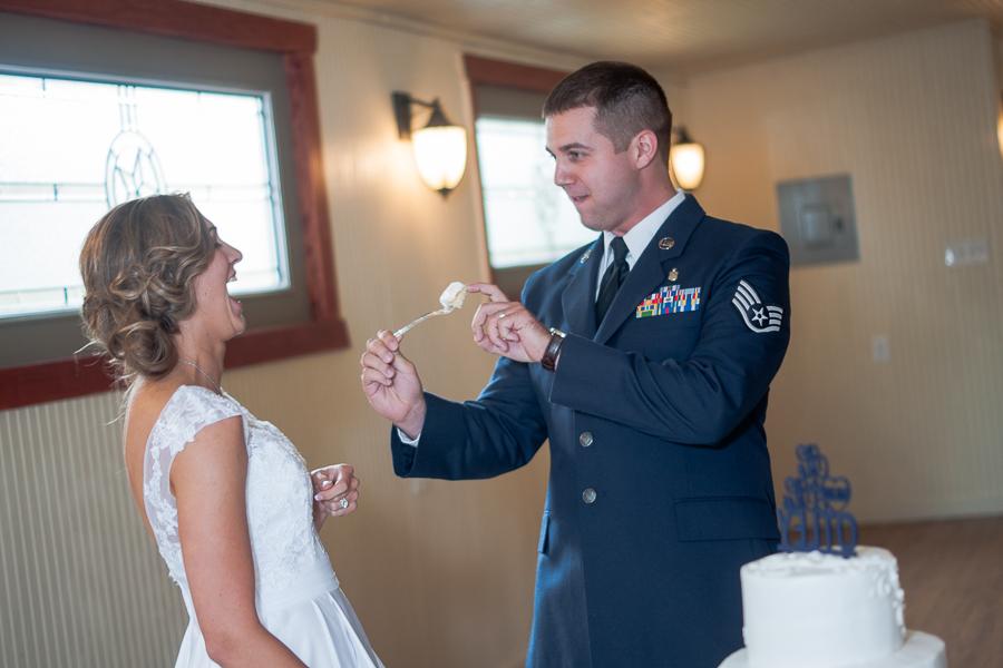 Bride and Groom Cutting Cake | San Antonio Wedding Photographer